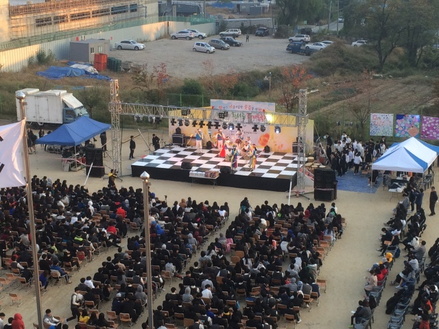 the stage and cheering students
