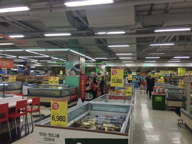 the brightly lit aisles of Homeplus