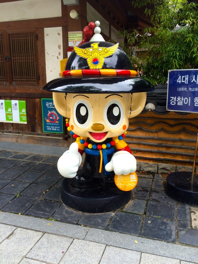 the police mascot wearing traditional Korean clothing